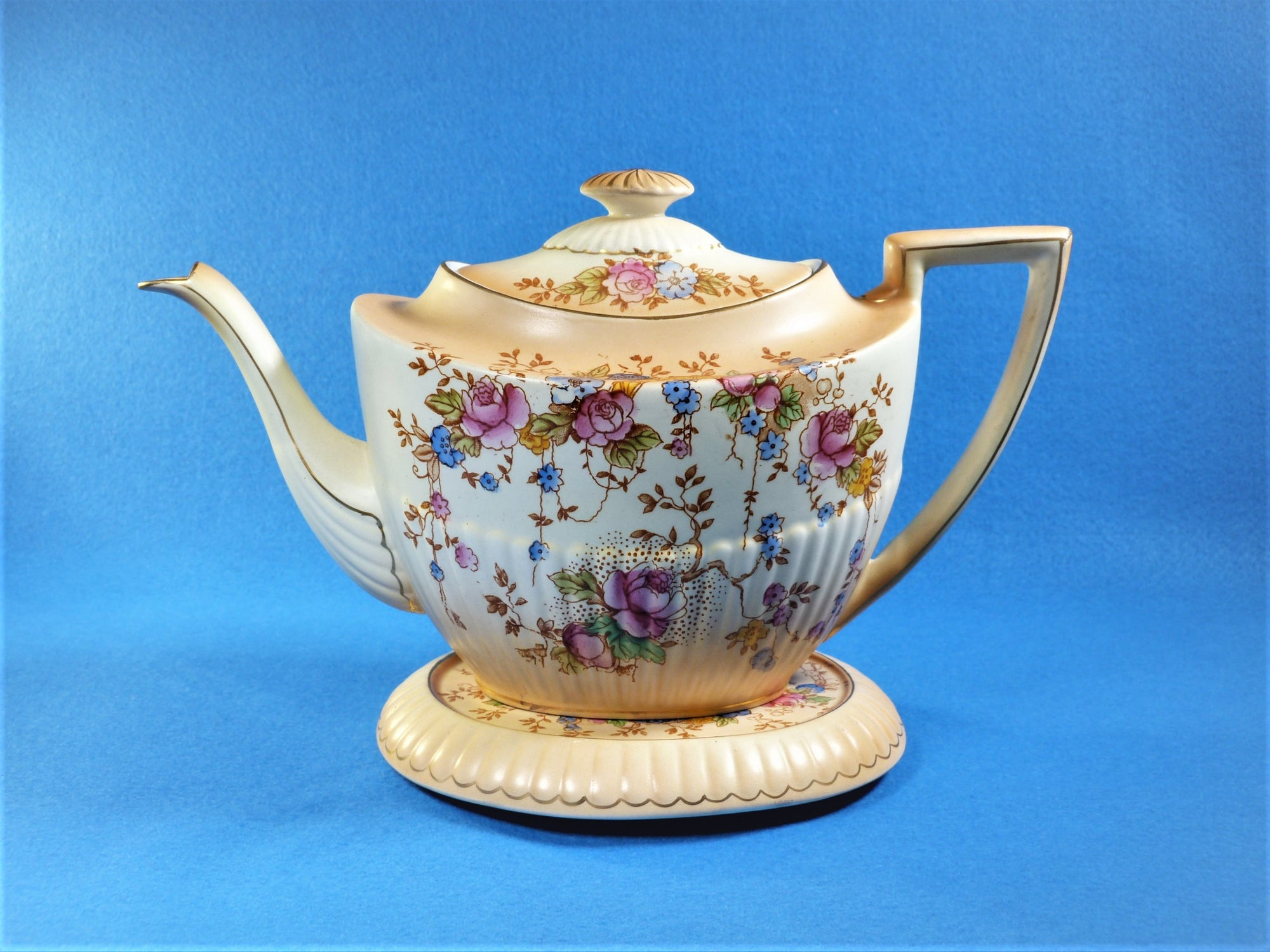 "Crown Devon Fielding's Teapot and Trivet Stand, ""Queen Ann May"" Pattern"