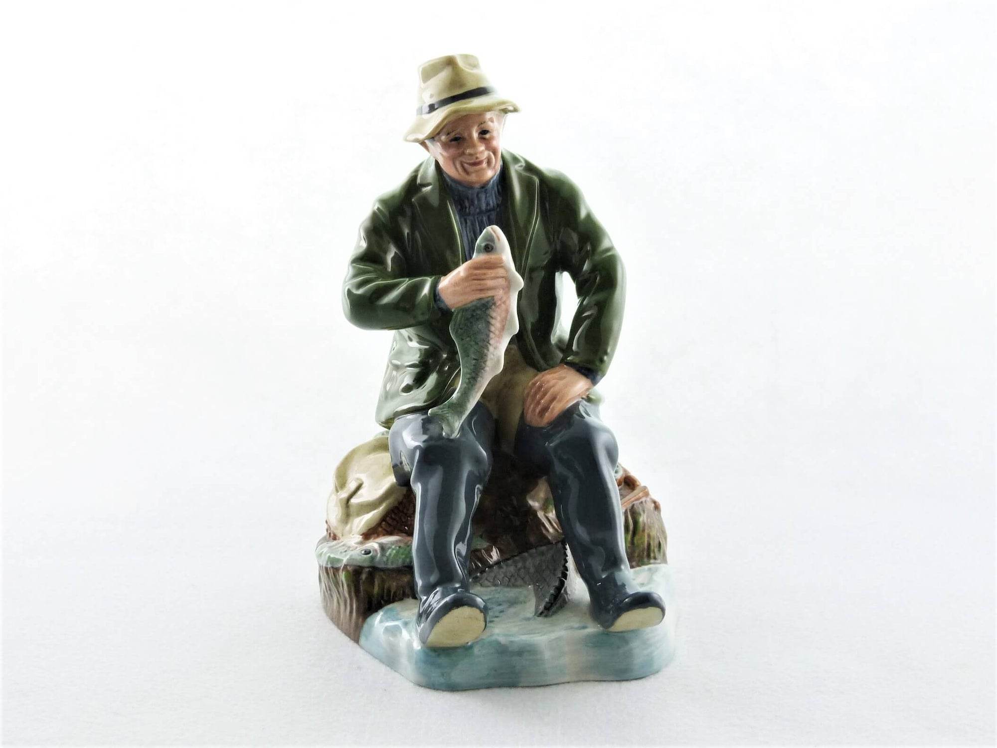 Royal Doulton Figurine, An Appealing Fisherman, HN2258, 'A Good Catch '