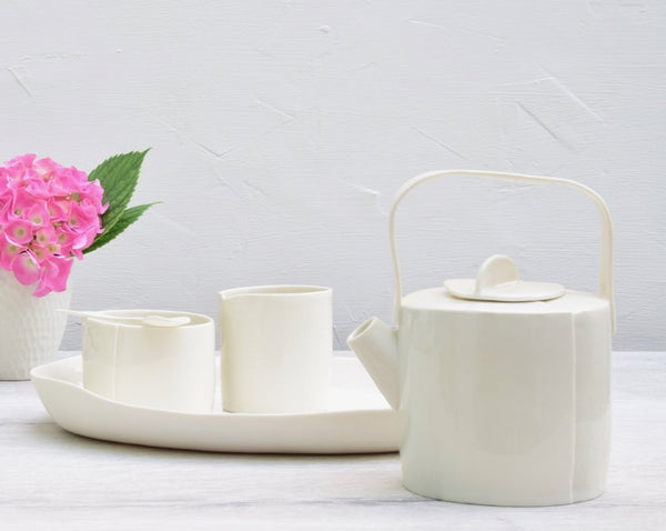 Teapot with sugar and milk set, white porcelain
