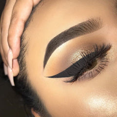 shaped brow with gold shadow and thick winged liner