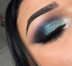 shaped brow with green eyeshadow and thick winged liner