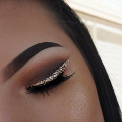 shaped brow with brown shadow and thick winged liner with glitter overlay