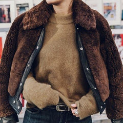 model in brown teddy jacket with fur collar