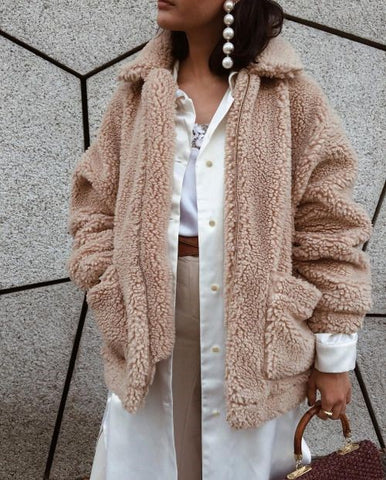 model in beige teddy style jacket