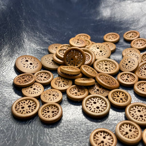 Fancy wooden button with patterned holes
