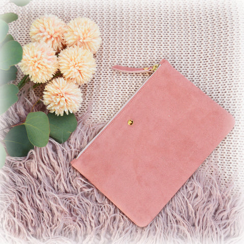 Pink suede mini clutch bag