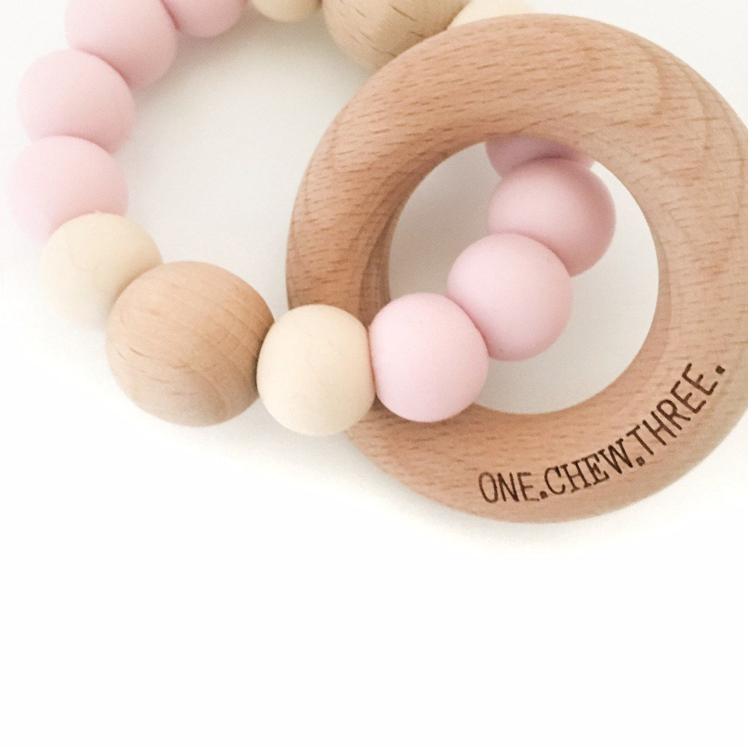 ONE CHEW THREE - SINGLE RATTLE SILICONE & BEECH WOOD TEETHER - PALE PINK & CREAM