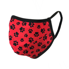 Load image into Gallery viewer, Namaske reusable fabric face mask with black paw prints on red fabric
