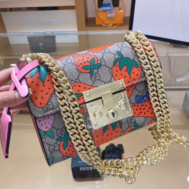 Padlock GG Strawberry small shoulder bag