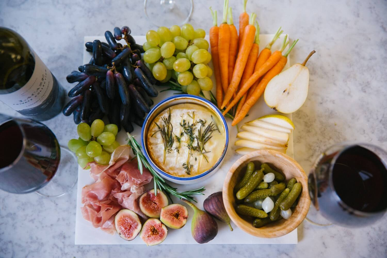Sharing board with crudites, baked camembert and honey