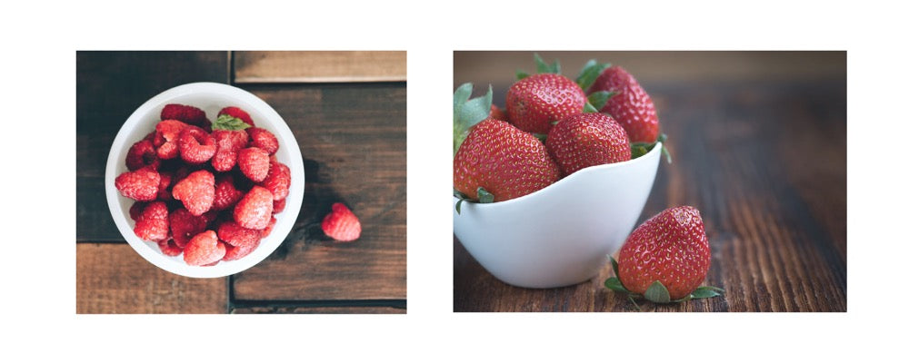strawberries and raspberries in two bowls
