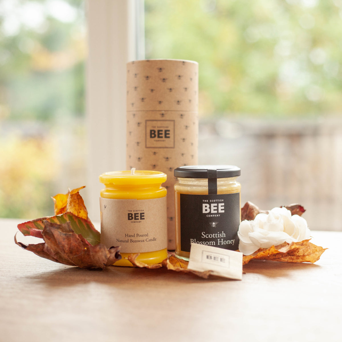 A gift pack of Scottish Blossom Honey and an unscented yellow beeswax candle
