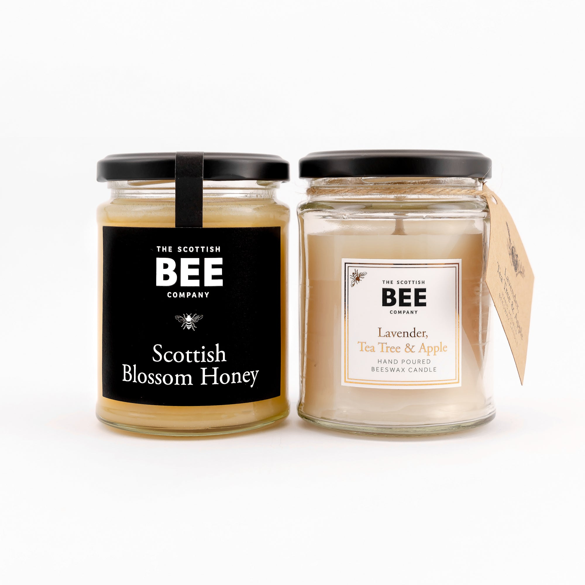A jar of Scottish Blossom Honey and a scented beeswax candle