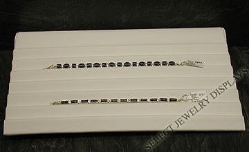"White Faux Leather Seven Slotted Bracelet Ramp Display 1-3/4"" H."