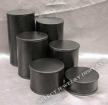 "Black Faux Leather 6-Pc Cylinder Riser Block Set Display 6-1/4"" H."