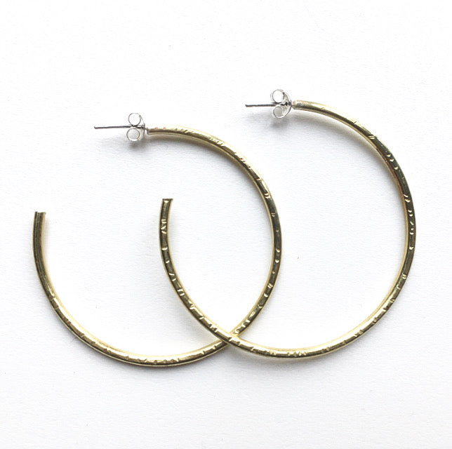 Large hand made hammered gold hoop earrings