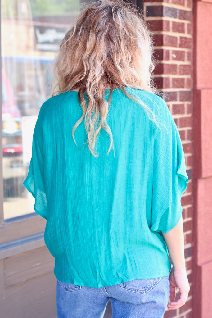 Jade Gathered Hem Surplice Blouse