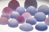 A collection of Blue Chalcedony and Purple Sage Chalcedony gemstones to be used in our iconic Mandala Rings.