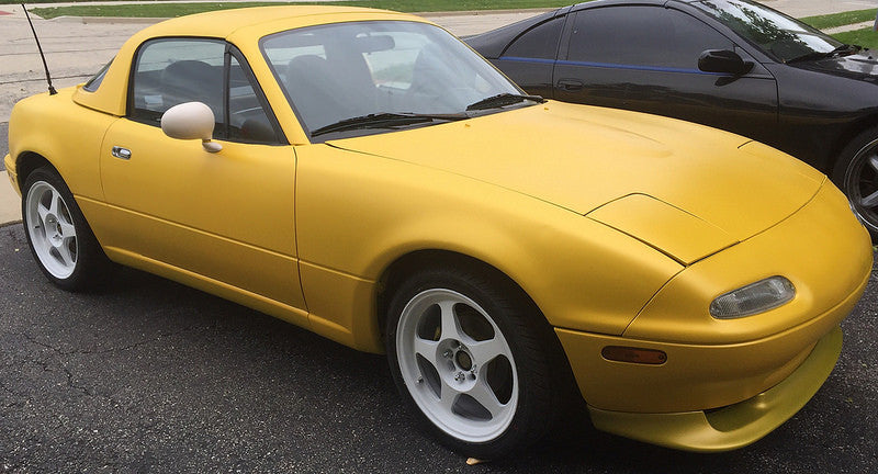 Plasti Dipped Miata!  Yellow base with Wu-Tang pearl.