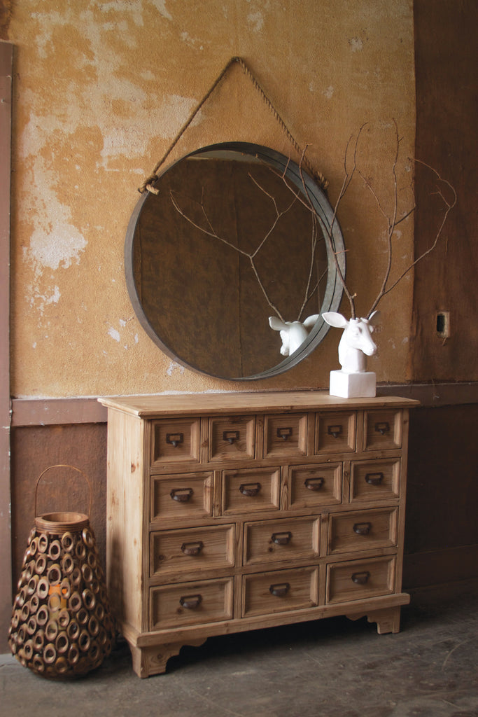 Large round metal mirror with rope hanger