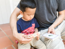 Load image into Gallery viewer, Asian boy practicing his CVC words using his phonetic reading block