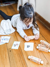 Load image into Gallery viewer, Girl playing with Montessori reading blocks