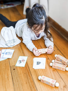 Girl playing with Montessori reading blocks