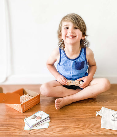 boy learning how to read using a Montessori-inspired language toy