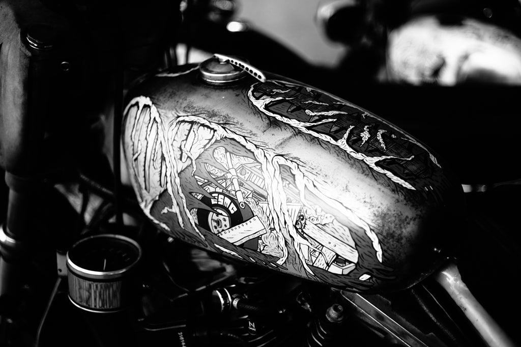Custom hand-painted motorcycle gas tank at Wheels and Waves Festival 2015