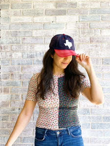Texas State Shape baseball hat. Hat color: Navy with Red bill and White felt