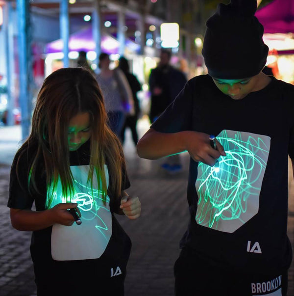 Illuminated Apparel Kids Interactive Glow In The Dark T-shirt in Black & Green Glow
