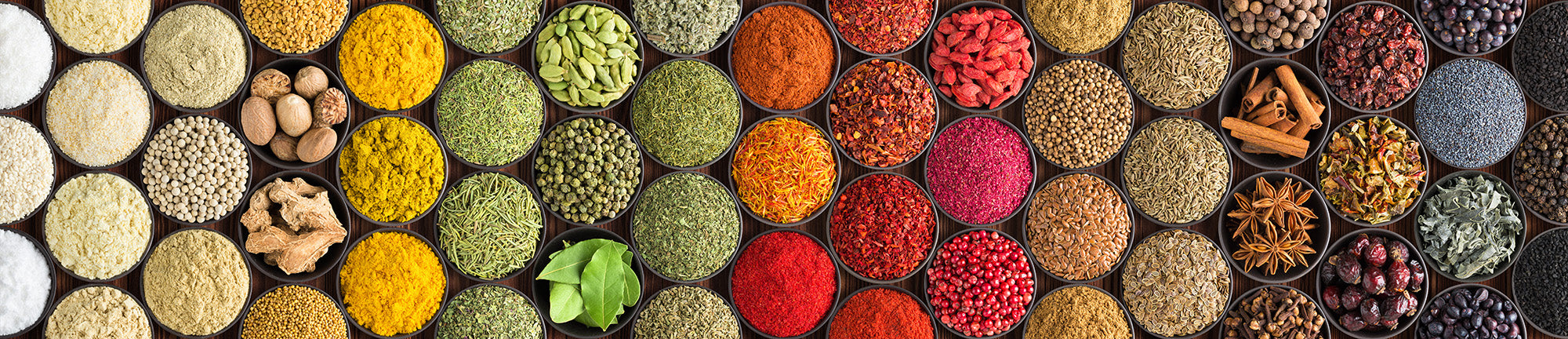 a collection of colorful spices from around the world