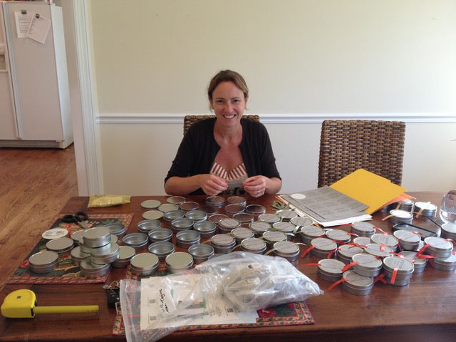 Jane hand-packing spices in their original tin.