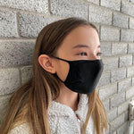 Girl wearing X-STATIC mask, side view