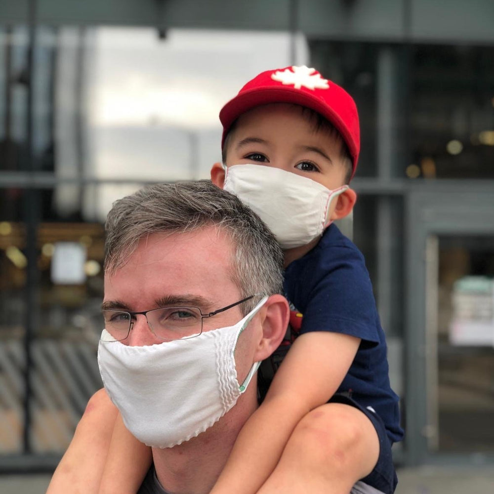 Kid and father wearing standard reusable masks