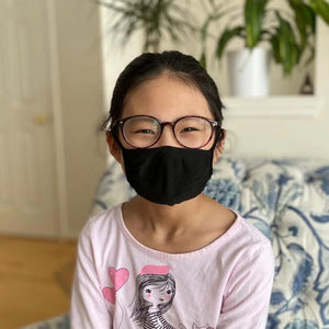 Young girl wearing X-STATIC mask