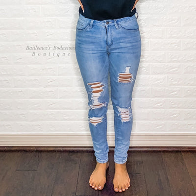 High rise distressed skinny jeans - Bailleaux's Bodacious Boutique