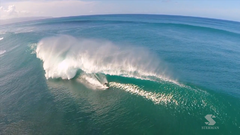 RC Helicam aerial video of big wave surfing