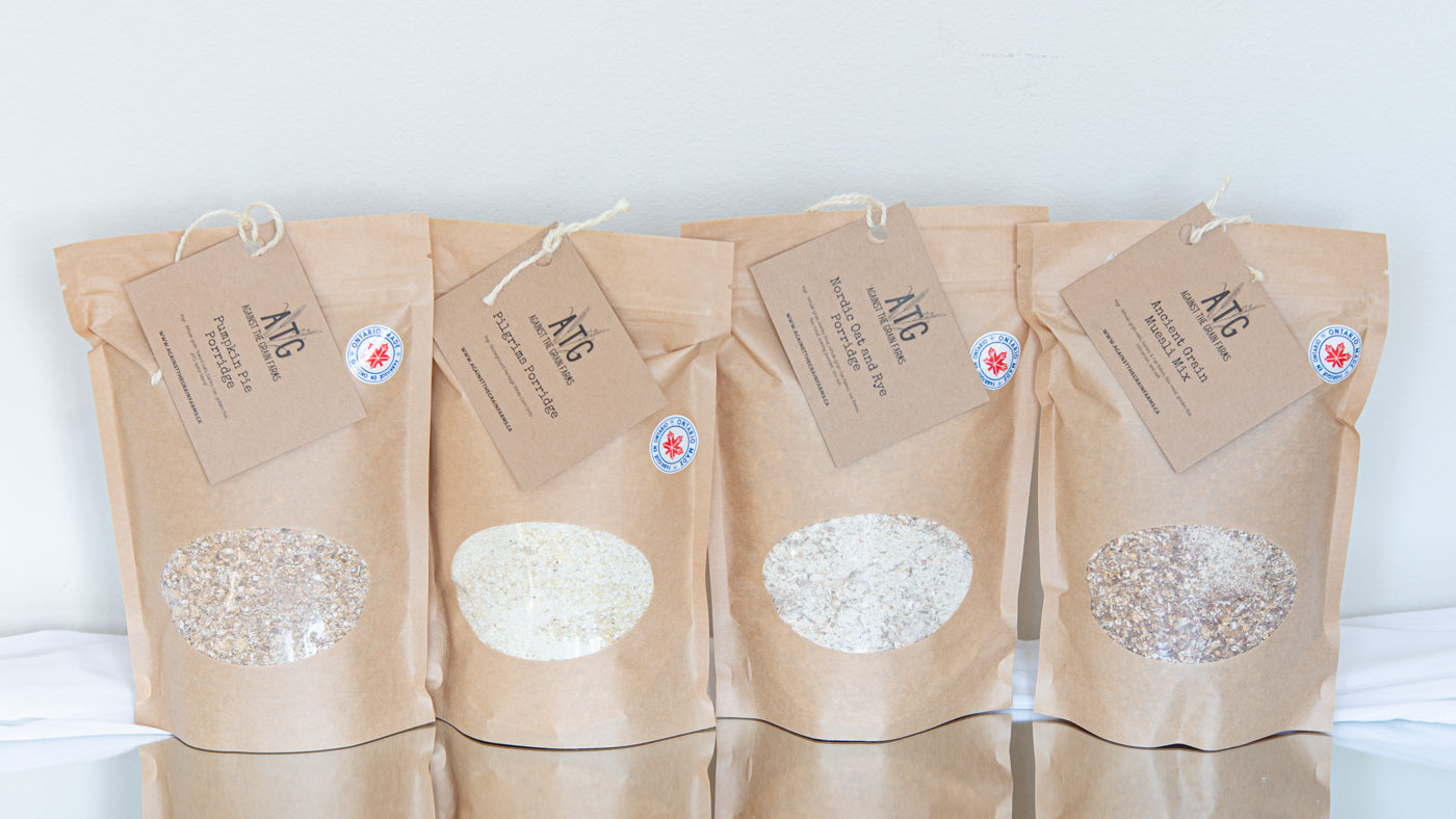 four paper bags filled with oats