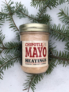 "jar ""chipotle mayo"" laying on spruce branch in white snow"