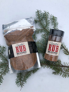 "package and small container ""signature rub"" on spruce branch in white snow"