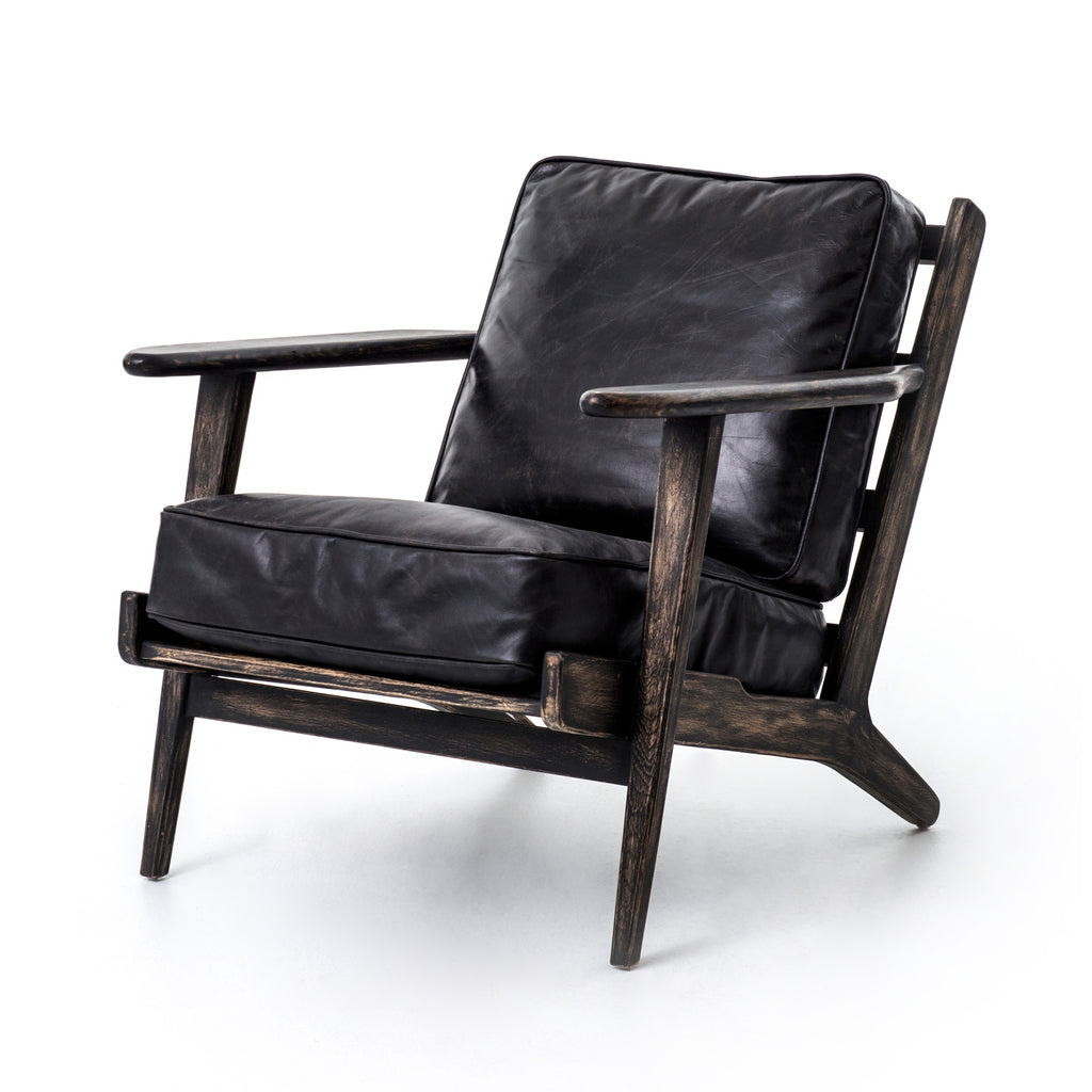 Wire-brushed oak is finished in black and hand-distressed for a naturally weathered patina.