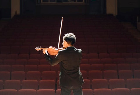 man playing violin at audition