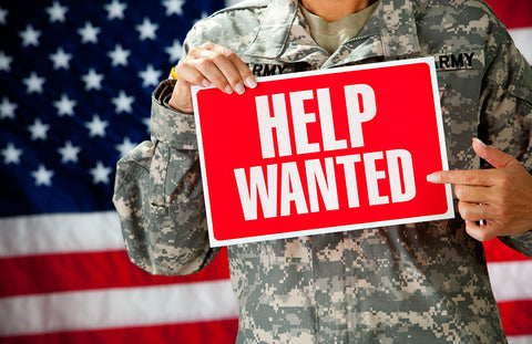 Veteran holding Help Wanted sign