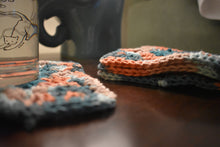 Load image into Gallery viewer, Coral and Teal Four Piece Granny Square Crochet Coasters Set (Set of 4)