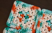 Load image into Gallery viewer, Teal, Coral, & Cream Granny Square Crochet Coasters Set (Set of 4)