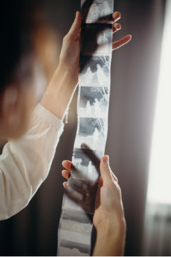Person Holding a strip of film up to light
