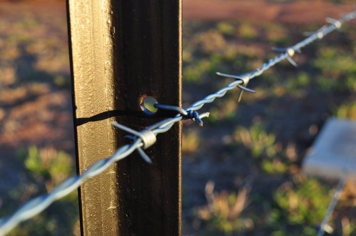 How to tie off barbed wire to a star post