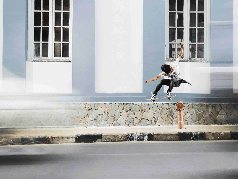a skateboarder on a quiet street