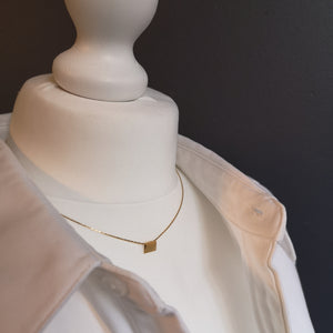 Finesse, the classic metal plate necklace.
